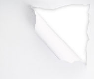 Torn paper sheet with an empty gap hole. As a copyspace background Royalty Free Stock Image