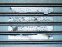 Torn paper on steel panel Stock Photo