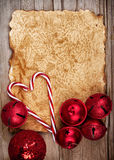Torn paper on wooden background with ornaments Royalty Free Stock Photo