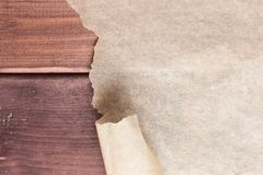 Torn paper. On wooden brown table stock photography