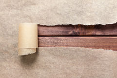 Torn paper. On wooden brown table stock images