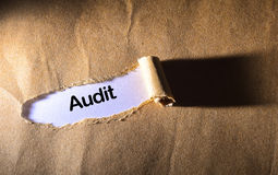 Torn paper with word audit Royalty Free Stock Image