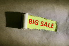 Torn paper with word BIG SALE. On yellow background Royalty Free Stock Image