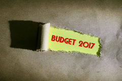 Torn paper with word BUDGET 2017. On yellow background Royalty Free Stock Image