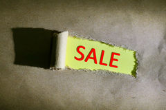 Torn paper with word sale. On yellow background Royalty Free Stock Photography