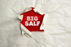 Torn paper writing big sale. Close up shot of torn paper writing big sale Royalty Free Stock Photography