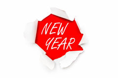 Torn paper with written words New Year Stock Photography