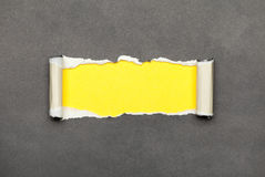 Torn paper with yellow space for your message Stock Image