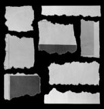 Torn papers on black. Eight pieces of torn newspaper on black background royalty free stock photo