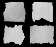Torn papers on black. Pieces of torn paper on black Stock Photos