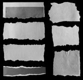 Torn papers. Pieces of torn paper on black stock photo