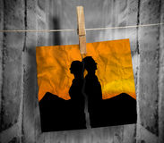 Torn photo of couple hung with a peg on a line Stock Photography