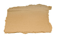 Torn Piece of Cardboard. Blank torn piece of corrugated cardboard.  Can be used as a business concept.  Isolated on white Stock Photo