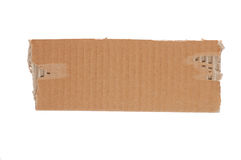 Torn Piece of Cardboard Royalty Free Stock Images
