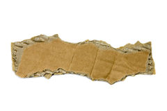 Torn piece of cardboard. Isolated on white Stock Photography
