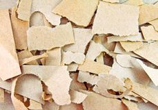 Torn pieces of brown paper Stock Images