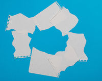 Torn pieces of checkered paper Stock Images