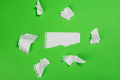 Torn pieces of checkered paper Royalty Free Stock Photo