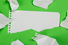 Torn pieces of checkered paper Stock Photo