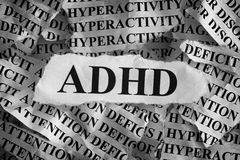 Torn pieces of paper with abbreviation ADHD. Concept Image. Black and White. ADHD is Attention deficit hyperactivity disorder. Close up. Vignette royalty free stock photos