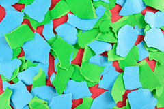 Torn pieces of paper background. Torn blue and green pieces of paper creating a colorful abstract background Royalty Free Stock Photo