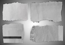 Torn pieces of paper. Pieces of torn paper on grey background royalty free stock photo