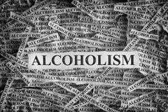 Torn pieces of paper with the word Alcoholism royalty free stock images