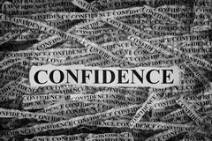 Torn pieces of paper with word Confidence. Confidence. Torn pieces of paper with word Confidence. Concept Image. Black and White. Closeup Royalty Free Stock Images