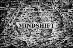 Torn pieces of paper with word Mindshift. Mindshift. Torn pieces of paper with word Mindshift. Concept Image. Black and White. Closeup royalty free stock images