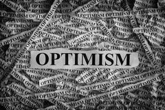 Torn pieces of paper with the word Optimism Stock Photos