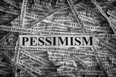 Torn pieces of paper with the word Pessimism Stock Photo