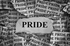 Torn pieces of paper with the word Pride Stock Photos