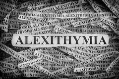 Torn pieces of paper with the words Alexithymia stock photos