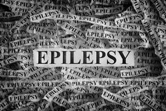 Torn pieces of paper with the words Epilepsy. Epilepsy. Torn pieces of paper with the words Epilepsy. Concept Image. Black and White. Closeup royalty free stock images