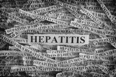 Torn pieces of paper with the words Hepatitis Royalty Free Stock Photo