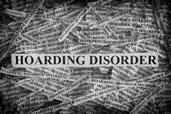 Torn pieces of paper with the words Hoarding Disorder. Hoarding Disorder. Torn pieces of paper with the words Hoarding Disorder. Concept Image. Black and White royalty free stock photography