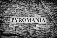 Torn pieces of paper with the words Pyromania royalty free stock images