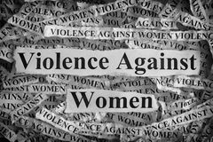 Torn pieces of paper with the words Violence Against Women Stock Image