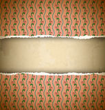 Torn pink ornamental wallpaper Royalty Free Stock Photo