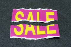 torn sale sign Stock Images