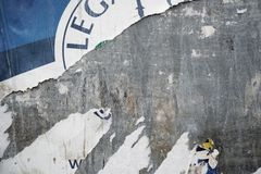 Torn poster after vote on tin textured wall. Ripped newspaper. Torn poster after vote on tin textured wall Ripped newspaper stock photography