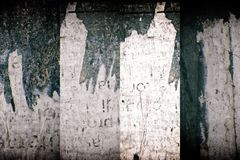 Torn poster after vote on tin textured wall. Ripped newspaper. Torn poster after vote on tin textured wall Ripped newspaper royalty free stock image