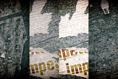 Torn poster after vote on tin textured wall. Ripped newspaper. Torn poster after vote on tin textured wall Ripped newspaper royalty free stock photos