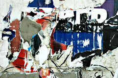 Torn Posters. Close up of entertainment event posters torn off a wall Royalty Free Stock Photos