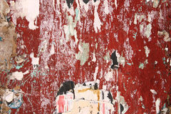 Torn posters background. Torn posters on old wall, vandalism and urban decay stock photos