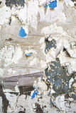 Torn posters close up. Old Weathered, torn poster wall closeup royalty free stock photos