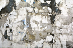 Torn posters close up. Old Weathered, torn poster wall closeup Stock Image