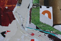 Torn posters. Close-up view of colorful torn posters stock photos