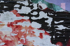 Torn posters. Close-up view of colorful torn posters royalty free stock image