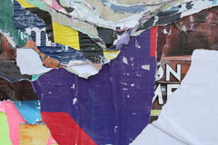 Torn posters. Close-up view of colorful torn posters royalty free stock images